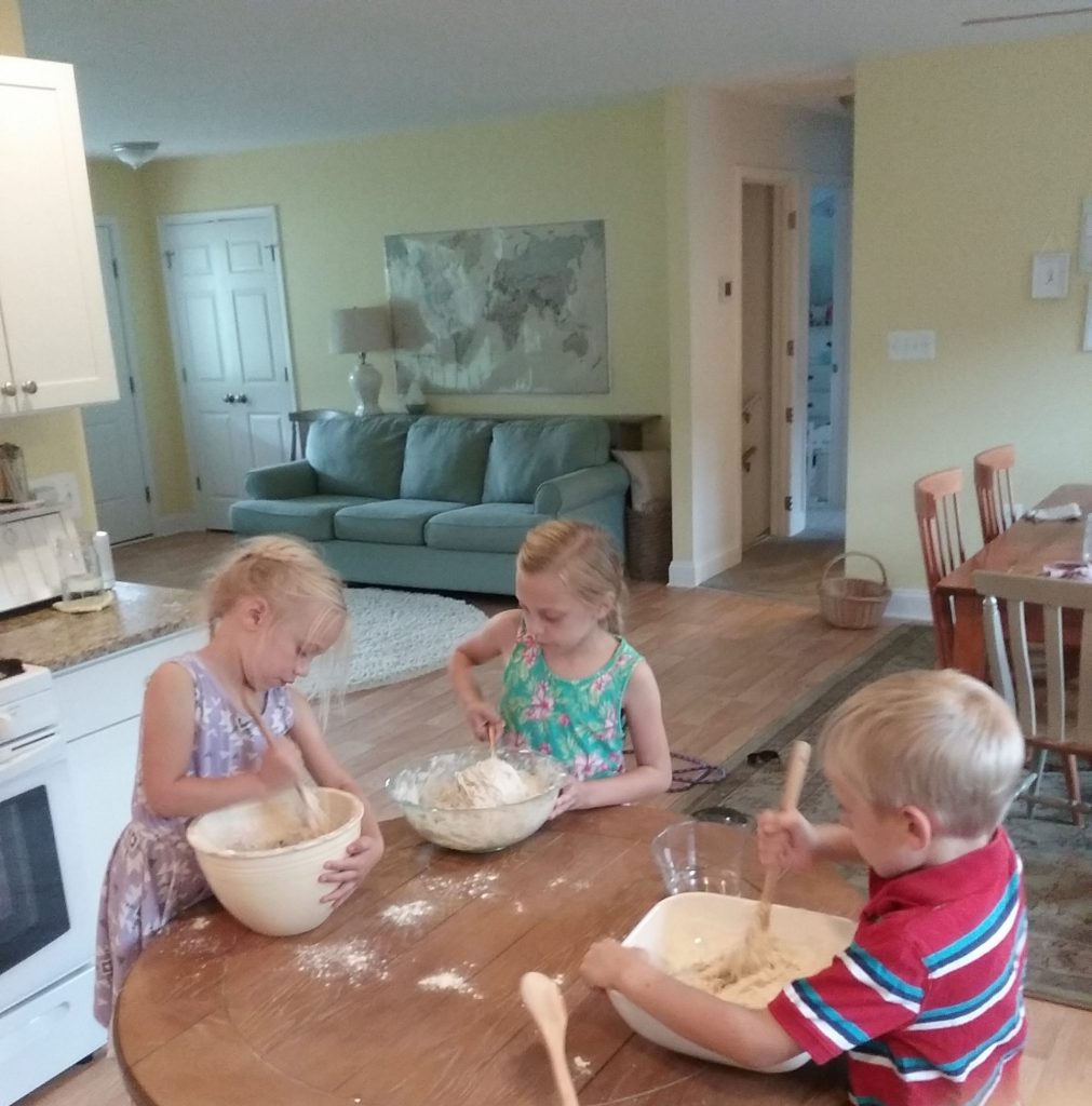 children helping in kitchen