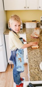 Child helping fix food in the kitchen